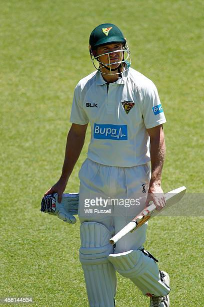George Bailey of the Tigers leaves the field after bing bowled by Nathan Rimmington of the Warriors during day one of the Sheffield Shield match...
