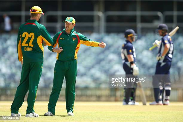 George Bailey of the Tigers talks with Jackson Bird during the JLT One Day Cup match between Victoria and Tasmania at WACA on October 4 2017 in Perth...