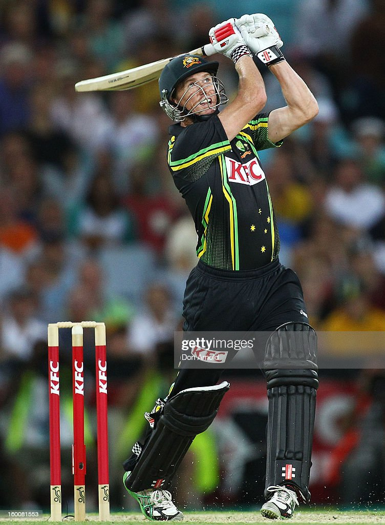 George Bailey watches the flight of the ball as he hits Thisara Perera into the stands for six during game one of the Twenty20 international match between Australia and Sri Lanka at ANZ Stadium on January 26, 2013 in Sydney, Australia.