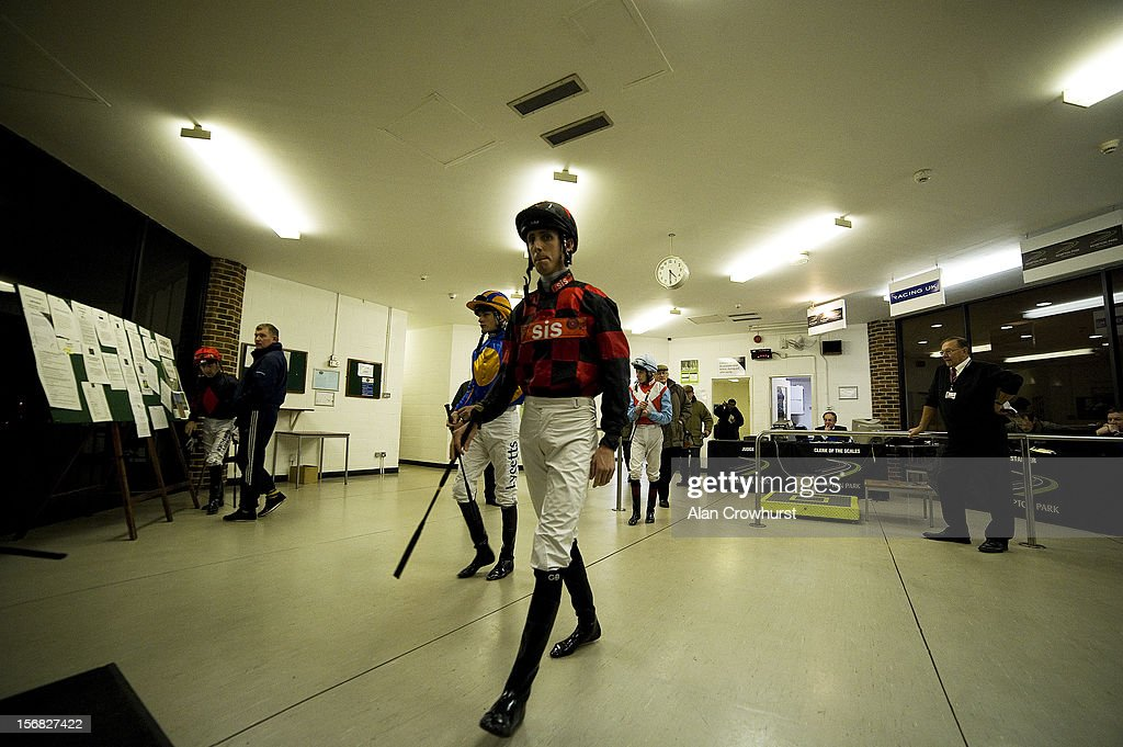 George Baker leads the jockeys out of the weighing room at Kempton racecourse on November 22, 2012 in Sunbury, England.