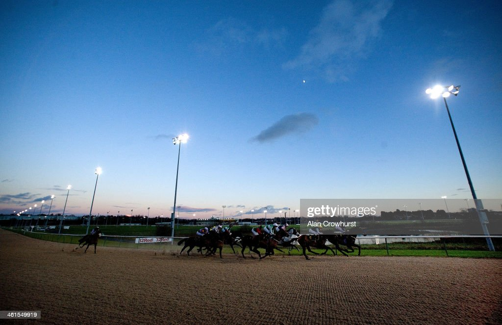 George Baker riding Interchoice Star win The Compare Bookmakers At bookmakerscouk Handicap Stakes at Wolverhampton racecourse on January 09 2014 in...