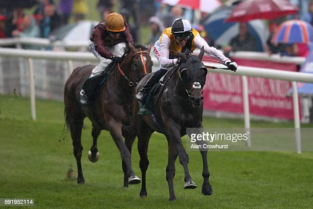 George Baker riding Quest For More win The Weatherbys Hamilton Lonsdale Cup at York racecourse on August 19 2016 in York England