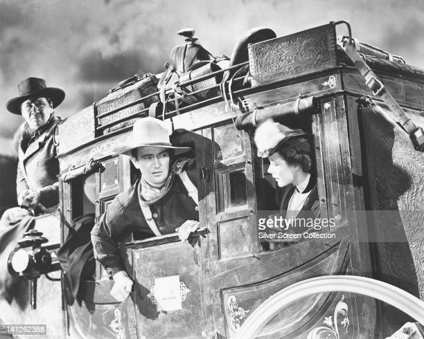 George Bancroft US actor John Wayne US actor and Louise Platt US actress riding a horsedrawn carriage in a publicity still issued for the film...