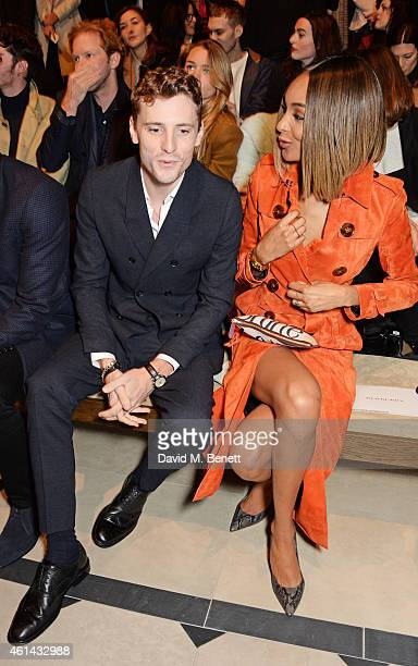 George Barnett and Jourdan Dunn attend the front row at Burberry Prorsum AW15 London Collections Men at Kensington Gardens on January 12 2015 in...