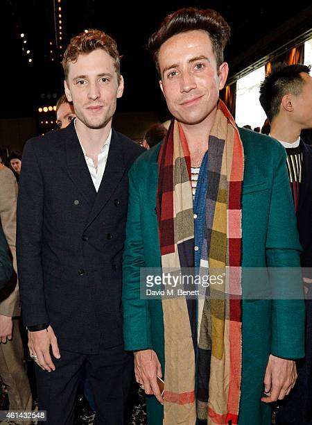 George Barnett and Nick Grimshaw attend the front row at Burberry Prorsum AW15 London Collections Men at Kensington Gardens on January 12 2015 in...