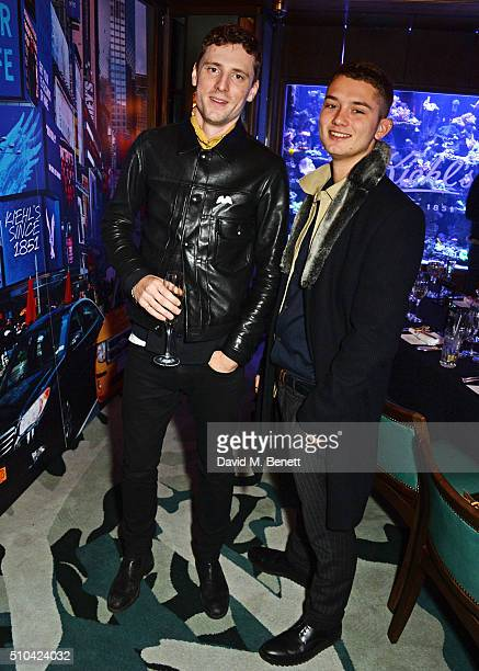 George Barnett and Rafferty Law attend the Kiehl's VIP dinner hosted by Pixie Geldof and Jack Guinness at Sexy Fish on February 15 2016 in London...