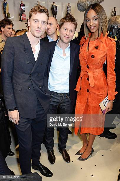 George Barnett Christopher Bailey and Jourdan Dunn pose backstage at Burberry Prorsum AW15 London Collections Men at Kensington Gardens on January 12...