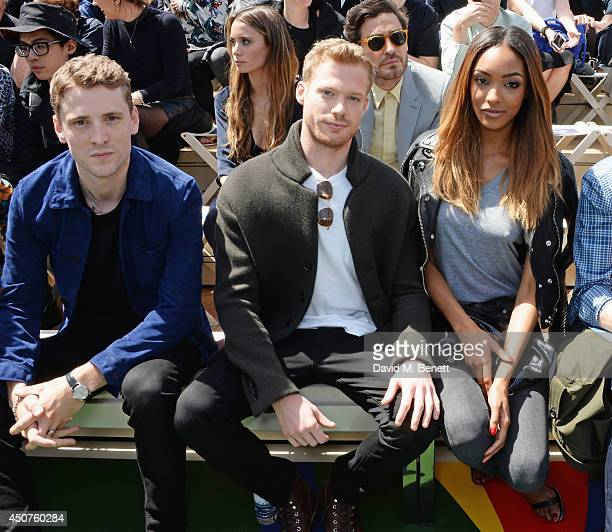 George Barnett Sam Reid and Jourdan Dunn sit in the front row at Burberry Prorsum SS15 during London Collections Men at Kensington Gardens on June 17...