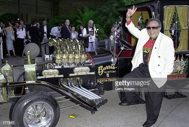George Barris arrives at the 26th Annual Saturn Awards in the car he created for the Munster television series June 6 2000 in Century City CA