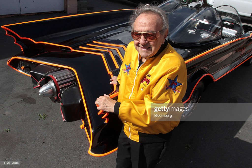 George Barris, creator of the Batmobile, poses with the car at the Barris Kustom Industries shop in North Hollywood, California, U.S., on Tuesday, March 22, 2011. Barris calls himself the 'King of the Kustomizers'. He's behind innumerable TV and movie cars, including the 'Back to the Future' DeLorean, 'The A Team' van and KITT Trans Am. Still, his most famous car will always be the Batmobile, fashioned in 1966. Photographer: Jonathan Alcorn/Bloomberg via Getty Images