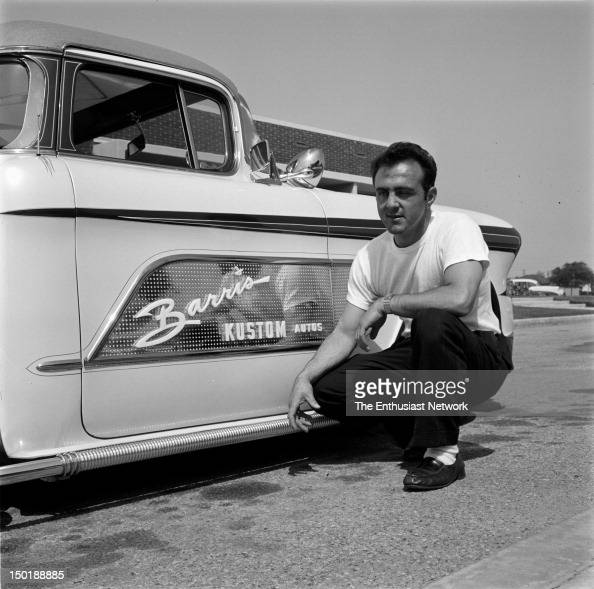 George Barris kneels next to his latest automotive custom creation the Copper Kart pickup truck