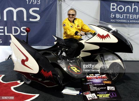 George Barris sits atop the Batcycle at the Barris Star Car Collection Auction at the Petersen Automotive Museum on May 13 2005 in Los Angeles...