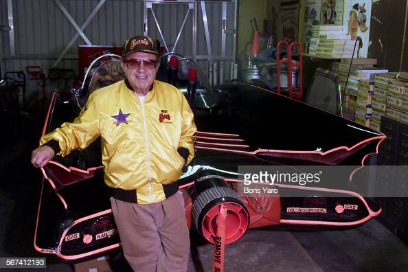 George Barris who has created many cars for motion picture and television shows stands in front of the Batmobile which he made ^^^/LA Times