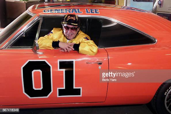George Barris who has created many famous cars for the motion picture and television industries sits in the 'General Lee' which was featured in the...