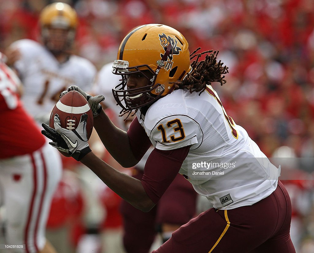 George Bell of the Arizona State Sun Devils catches a pass for a first down against the Wisconsin Badgers at Camp Randall Stadium on September 18...