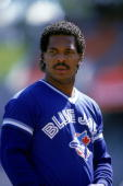 George Bell of the Toronto Blue Jays rests during a 1987 game against the Oakland Athletics at the OaklandAlameda Coliseum in Oakland California