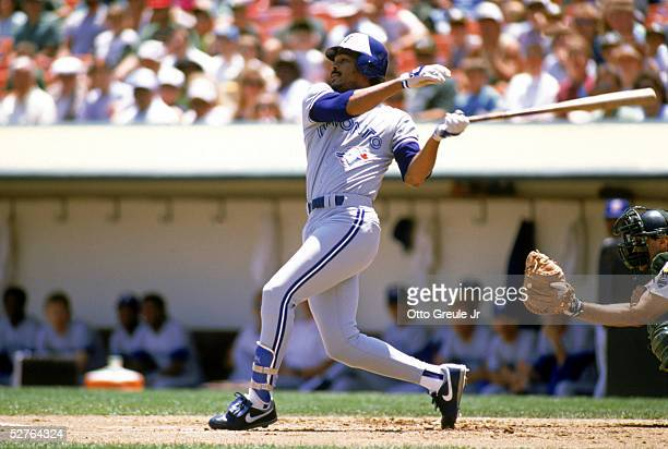 George Bell of the Toronto Blue Jays swings at a pitch during a 1989 game against the Oakland Athletics at the OaklandAlameda Coliseum in Oakland...
