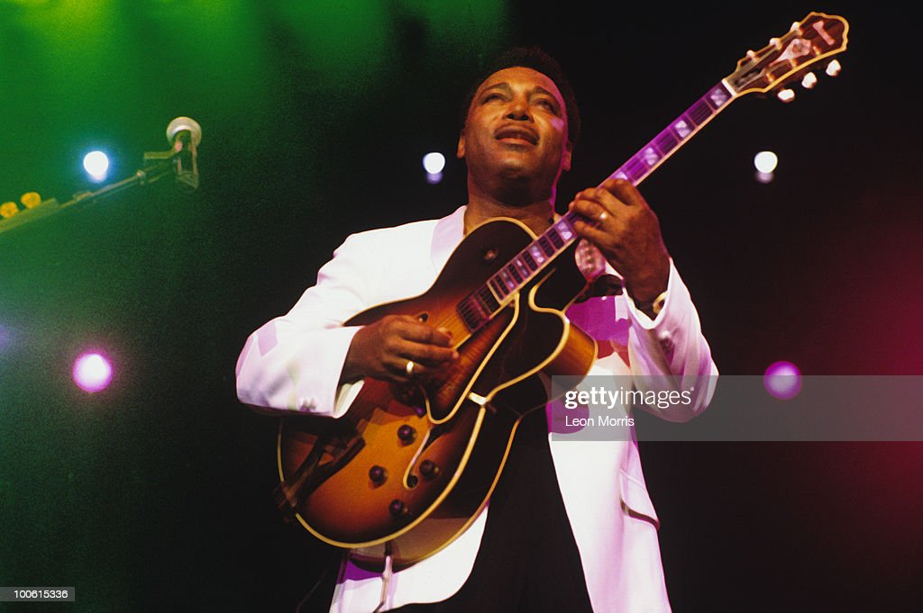 George Benson performs on stage in 1996.