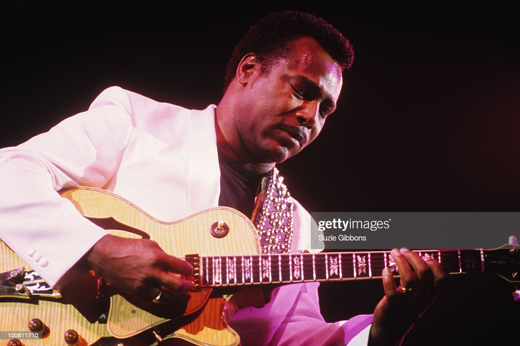 George Benson performs on stage in the 1980's.