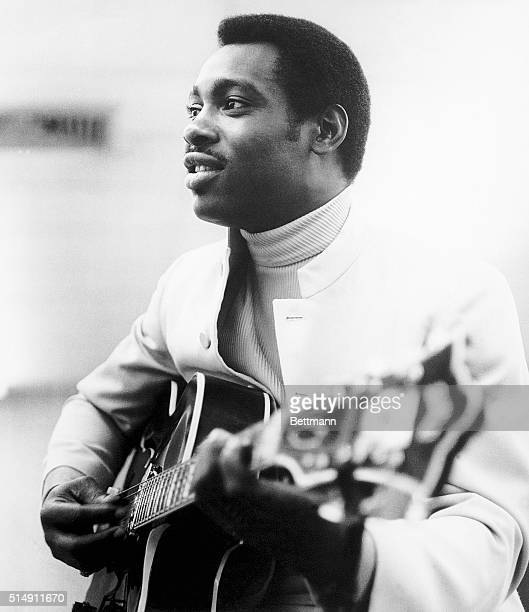 George Benson playing the guitar in the 1960's