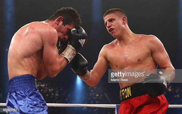 George Beroshvili of Georgia exchanges punches with Tyron Zeuge of Germany during their middle weight fight at HansMartinSchleierHalle on January 25...