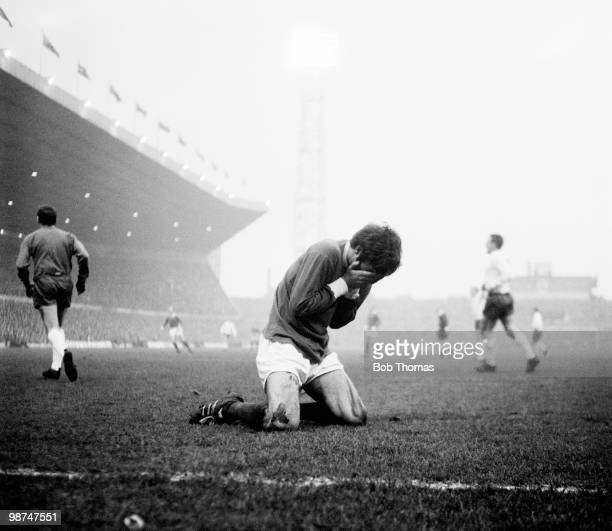 George Best of Manchester United sinks to his knees during a match against Tottenham Hotspur at Old Trafford in Manchester circa 1968