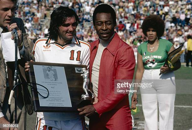 George Best presents Pele with a plaque commemorating the Brazilian as the best soccer player in the world during Pele Appreciation Day at Rose Bowl...