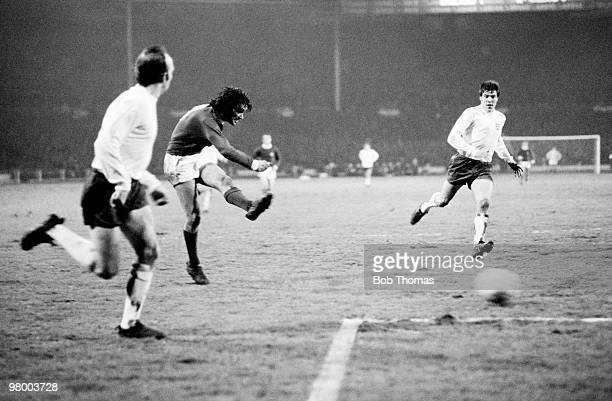 George Best shoots watched by England defenders Nobby Stiles and Emlyn Hughes to score for Northern Ireland during the British Home International...
