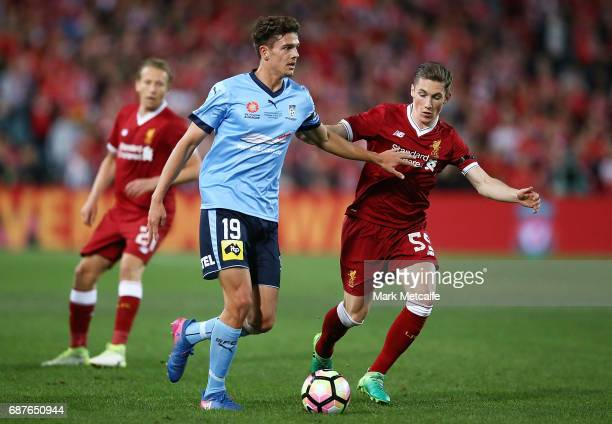 George Blackwood of Sydney FC is challenged by Harry Wilson of Liverpool during the International Friendly match between Sydney FC and Liverpool FC...