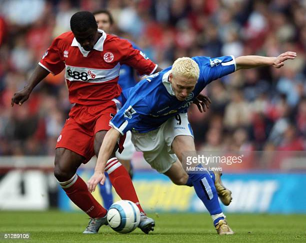 George Boateng of Middlesbrough tackles Mikael Forssell of Birmingham during the Barclays Premiership match at The Riverside Stadium on September 11...