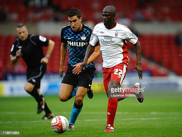 George Boateng of Nottingham Forest battles for the ball with Kevin Strootman of PSV during the Pre Season Friendly match between Nottingham Forest...