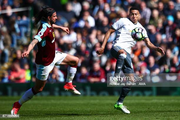 George Boyd of Burnley and Jesse Lingard of Manchester United during the Premier League match between Burnley and Manchester United at Turf Moor on...