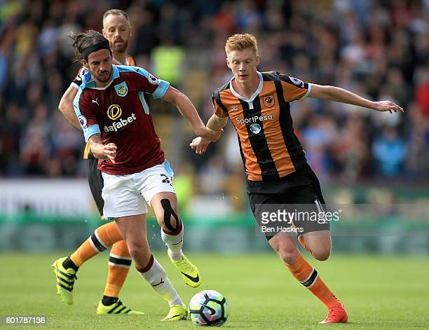 George Boyd of Burnley and Sam Clucas of Hull City battle for possession during the Premier League match between Burnley and Hull City at Turf Moor...