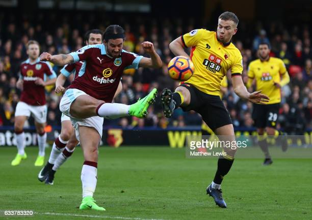George Boyd of Burnley and Tom Cleverley of Watford compete for the ball during the Premier League match between Watford and Burnley at Vicarage Road...
