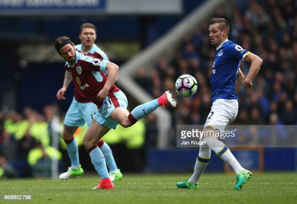 George Boyd of Burnley attempts to control the ball while under pressure from Morgan Schneiderlin of Everton during the Premier League match between...