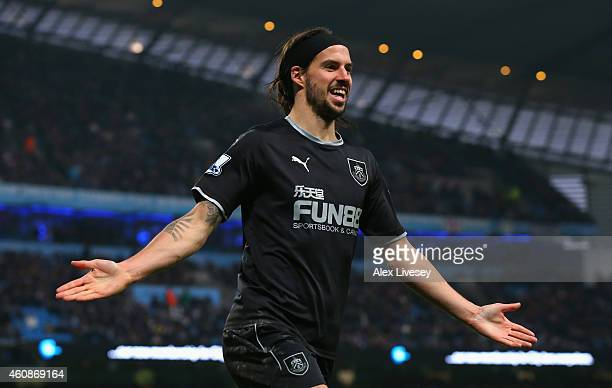 George Boyd of Burnley celebrates scoring their first goal during the Barclays Premier League match between Manchester City and Burnley at Etihad...