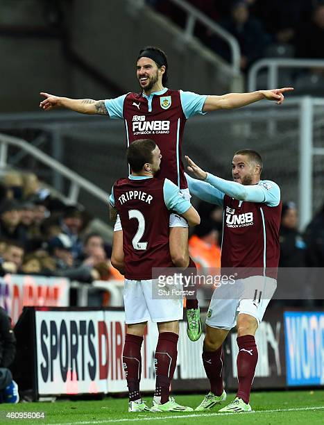 George Boyd of Burnley is lifted up after scoring the third Burnley goal during the Barclays Premier League match between Newcastle United and...