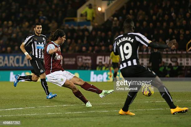 George Boyd of Burnley scores the opening goal during the Barclays Premier League match between Burnley and Newcastle United at Turf Moor on December...