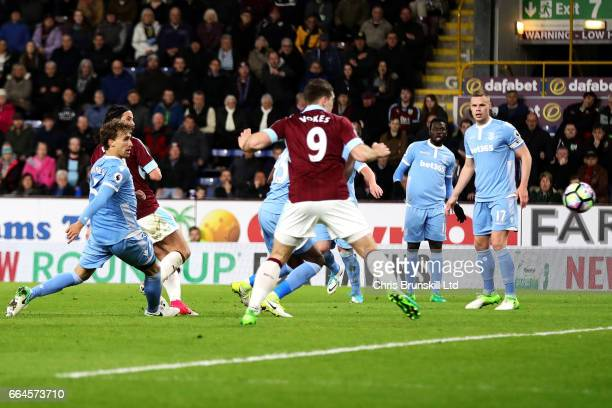 George Boyd of Burnley scores the opening goal during the Premier League match between Burnley and Stoke City at Turf Moor on April 4 2017 in Burnley...