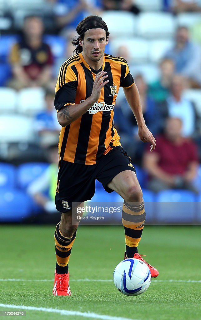 George Boyd of Hull City runs with the ball during the pre season friendly match between Peterborough United and Hull City at London Road Stadium on July 29, 2013 in Peterborough, England.
