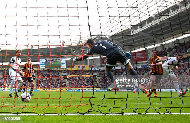 George Boyd of Hull City scores the match wining goal past goalkeeper Michel Vorm of Swansea during the Barclays Premier league match between Hull...