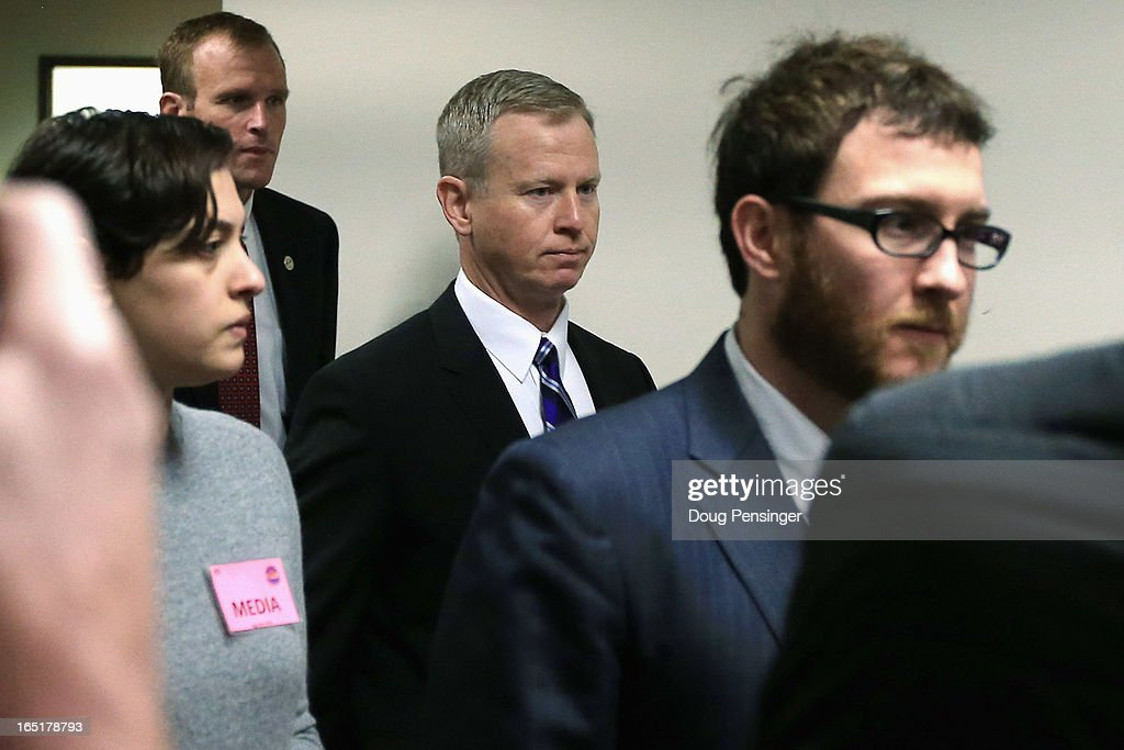 George Brauchler (C), District Attorney in Colorado's 18th Judical District, arrives at the courtroom for a hearing on Aurora theater shooting suspect James Holmes in the Arapahoe County Justice Center on April 1, 2013 in Centennial, Colorado. Prosecutors have said they will seek the death penalty for suspect James Holmes, who is charged with 166 counts of murder, attempted murder and other crimes in the Aurora theater shooting on July 20, 2012.