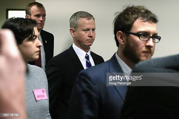 George Brauchler District Attorney in Colorado's 18th Judical District arrives at the courtroom for a hearing on Aurora theater shooting suspect...