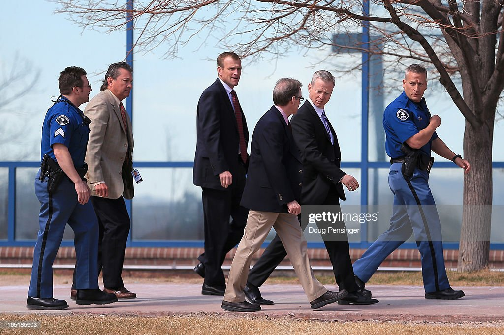 George Brauchler (2nd R), District Attorney in Colorado's 18th Judical District, walks with the prosecution team after leaving the courthouse after announcing during a hearing that they will seek the death penalty for Aurora theater shooting suspect James Holmes on April 1, 2013 in Centennial, Colorado. The suspect James Holmes is charged with 166 counts of murder, attempted murder and other crimes in the Aurora theater shooting on July 20, 2012.
