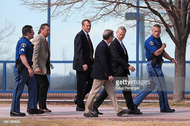George Brauchler District Attorney in Colorado's 18th Judical District walks with the prosecution team after leaving the courthouse after announcing...