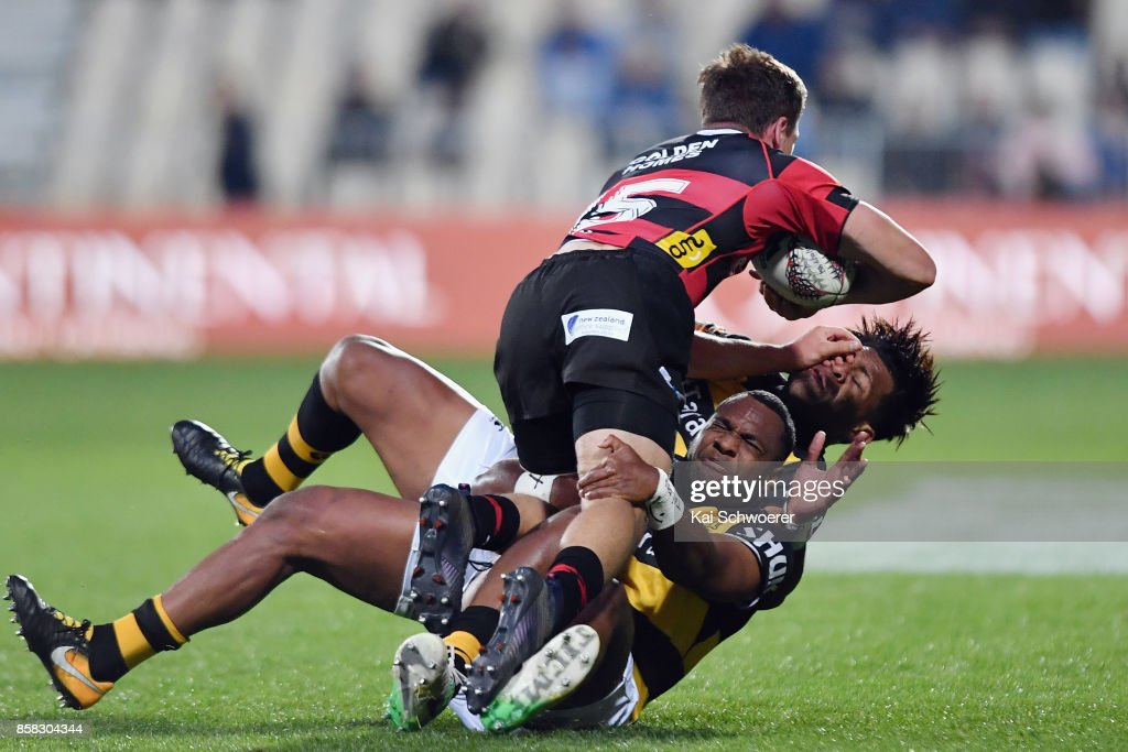 George Bridge of Canterbury is tackled by Manasa Mataele of Taranaki and Seta Tamanivalu of Taranaki (L-R) during the round eight Mitre 10 Cup match between Canterbury and Taranaki at AMI Stadium on October 6, 2017 in Christchurch, New Zealand.