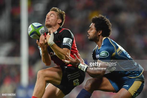 George Bridge of the Crusaders and Henry Speight of the Brumbies compete for the ball during the round one Super Rugby match between the Crusaders...