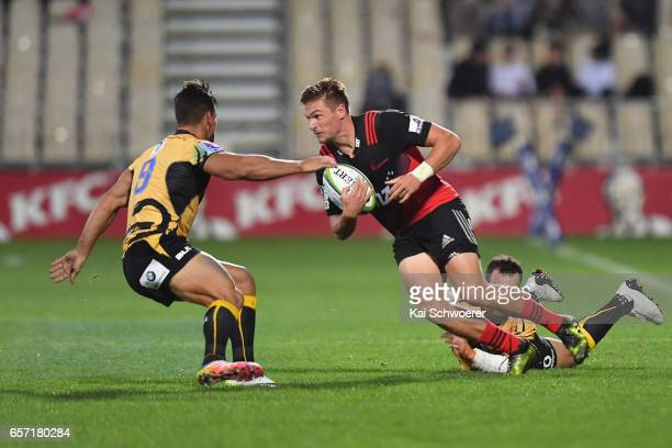 George Bridge of the Crusaders is tackled by Ryan Louwrens of the Force and Jono Lance of the Force during the round five Super Rugby match between...