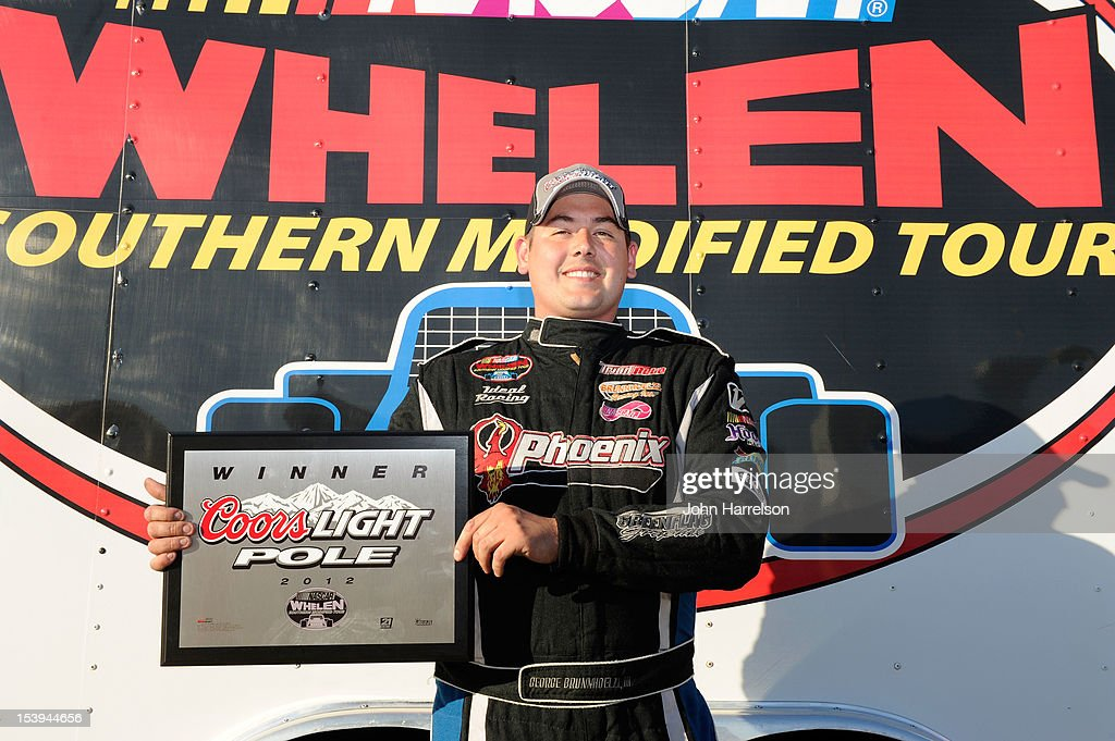 George Brunnhoelzl, III poses with the Coors Light Pole Award after qualifying for pole position for the NASCAR Whelen Southern Modified Tour UNOH Southern Slam 150 at Charlotte Motor Speedway on October 11, 2012 in Charlotte, North Carolina.