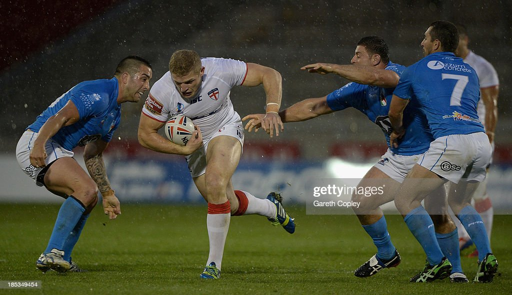George Burgess of England finds a gap in the Italian line during the International match between England and Italy at Salford City Stadium on October 19, 2013 in Salford, England.